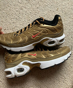Nike tunes TNS Gold with red details