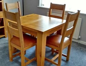 details about solid oak extendable dining table and four chairs