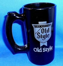 OLD STYLE BEER MUG BLACK GLASS 5.5 INCES TALL BY ABOUT 4.75 INCHES ACROSS HANDLE