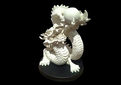 Dragon Statue on Black Stand. Chinese Dragon.