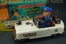 NOMURA. MYSTERY POLICE CAR. + BOITE.  battery toys.
