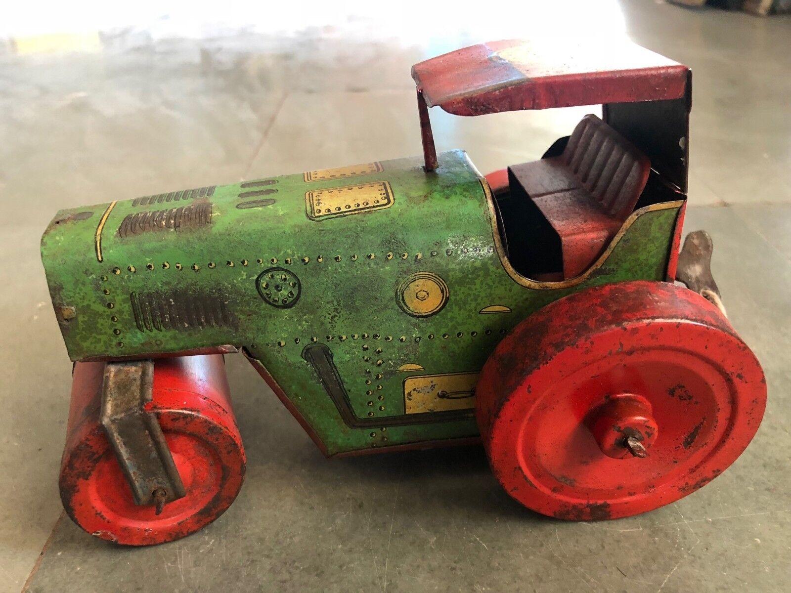 Vintage 'K' marca Litografía Road Roller Wind Up juguete de estaño