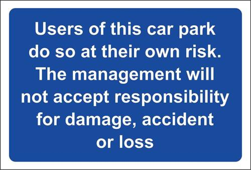 The users of this car park do so at their own risk safety sign
