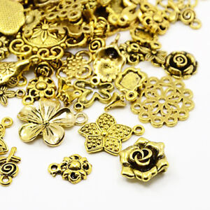 Packet 30 Grams Antique Gold Tibetan 5-40mm Flower Charm/Pendant Mix HA07090 55711136197