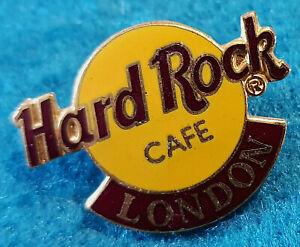 Londres-Inglaterra-Clasico-Pequeno-Naranja-Logo-Tac-Espalda-1LC-Serif