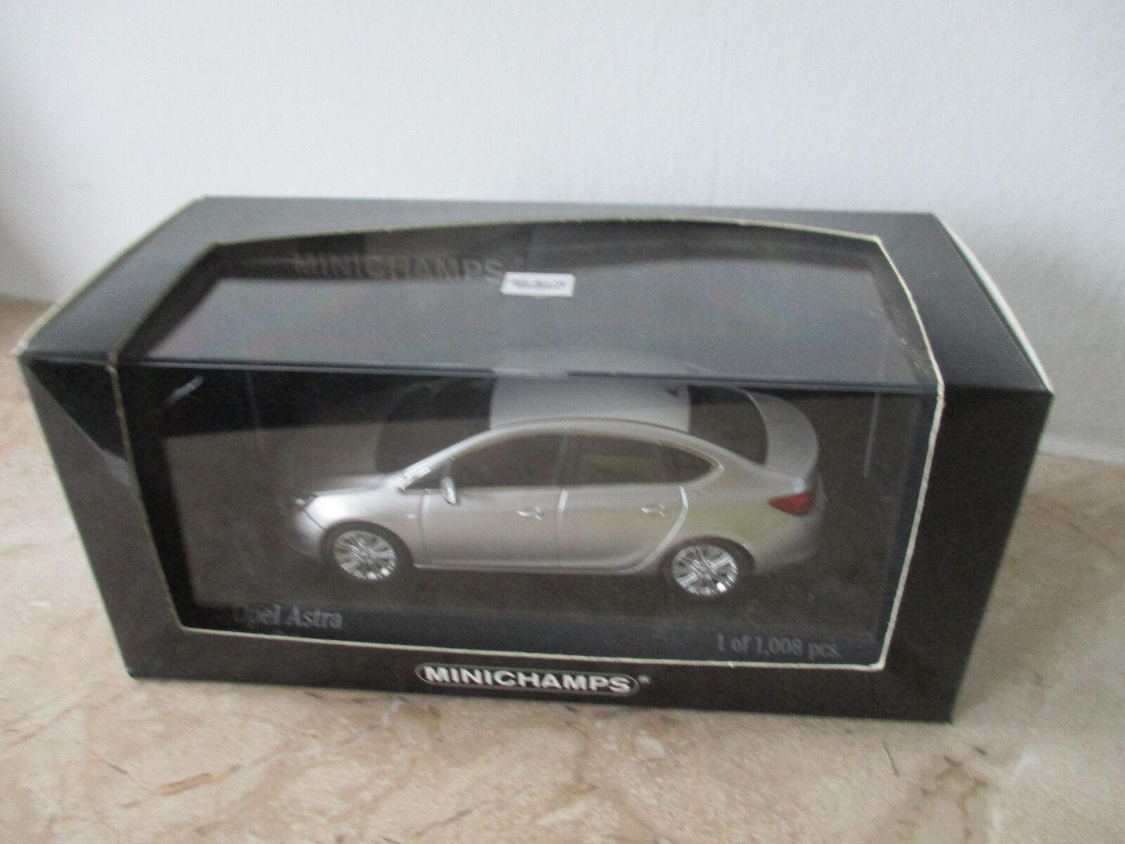 Modellauto MINICHAMPS Opel Astra 2012 2012 2012 4-Door Argonsilver  Maßstab 1 43 mit OVP 699897