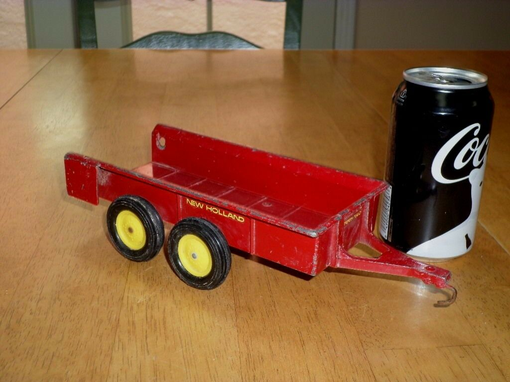 ERTL COMPANY - NEW HOLLAND TRAILER, PRESSED STEEL METAL TOY, SCALE 1 18, VINTAGE