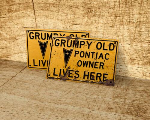 Grumpy old Pontiac owner lives here sign for garage man cave
