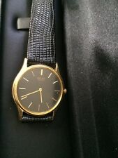 Seiko Quartz Mid-size  Gold  Tone Leather Band Steel  Gold Stick Markers.