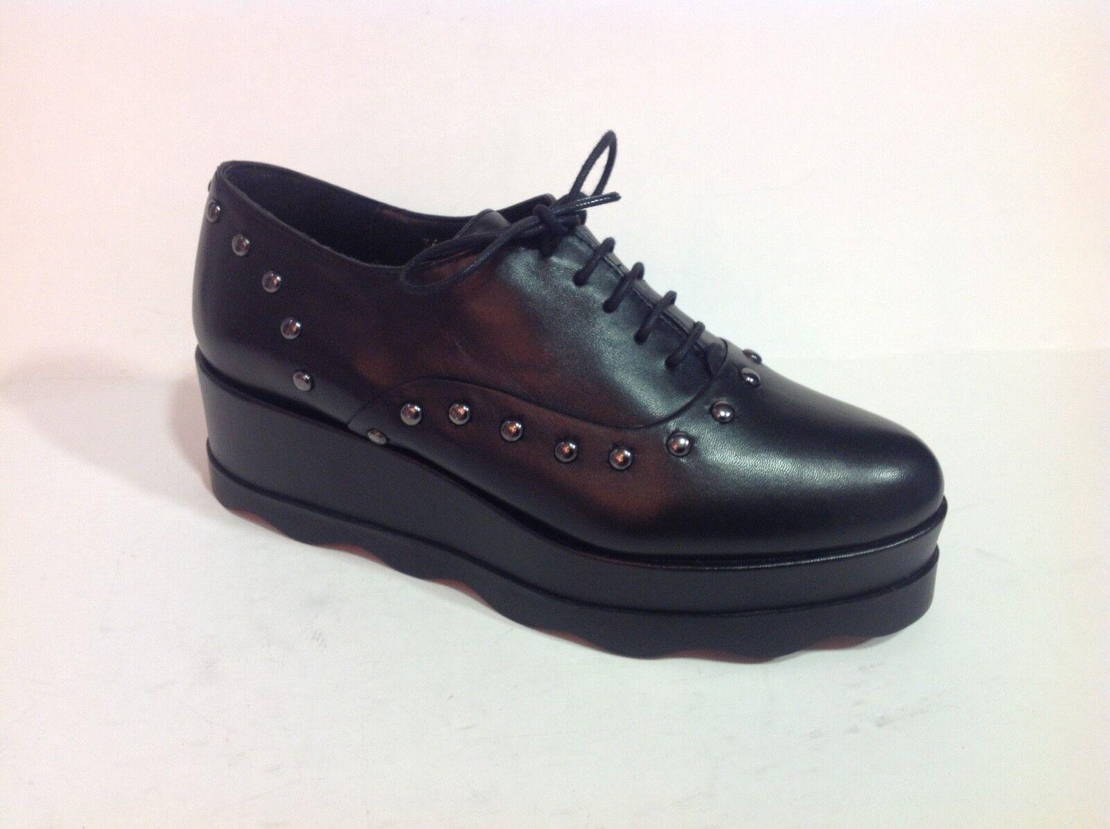 chaussure femme derby Bruno Premi en cuir noir sur plateau de 5 cm pointure 36