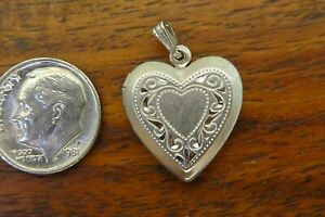 Vintage-silver-BEAUCRAFT-HEART-FILIGREE-LOCKET-PHOTO-HOLDER-MOVABLE-charm-BEAU