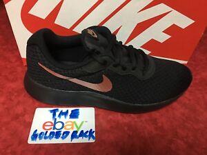 b19c373a29a6 Image is loading Nike-Tanjun-Womens-812655-005-Black-Metallic-Bronze-