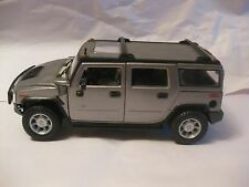 Hummer H2 SUV In A Silver 127 Scale Diecast With Opening Doors From Maisto dc125