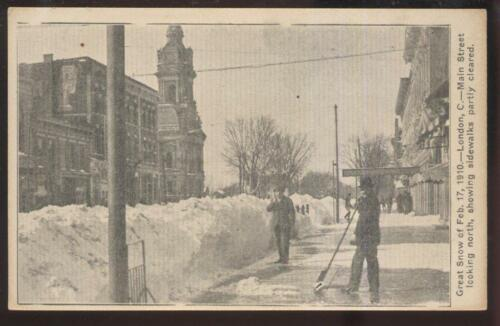 1910s POSTCARD LONDON OH FEB 17, 1910 SNOWSTORM CLEAN UP AFTERMATH ON MAIN ST
