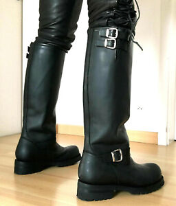 Round toe lace up boots 37 inches tall shafts made in thick full grain leather .