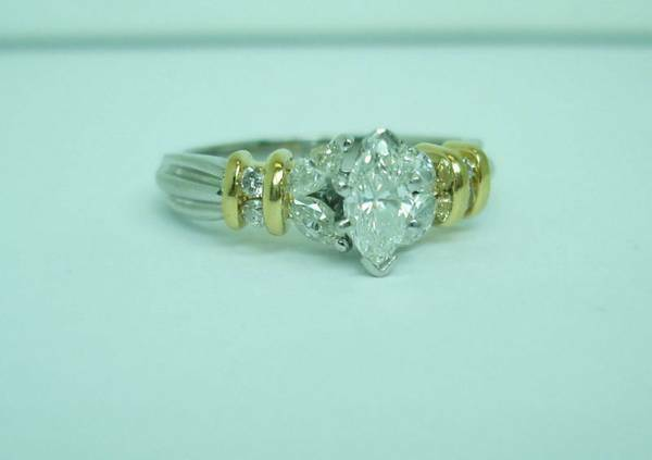 18 karat marquise shaped diamond ring size 7 with appraisal engagement