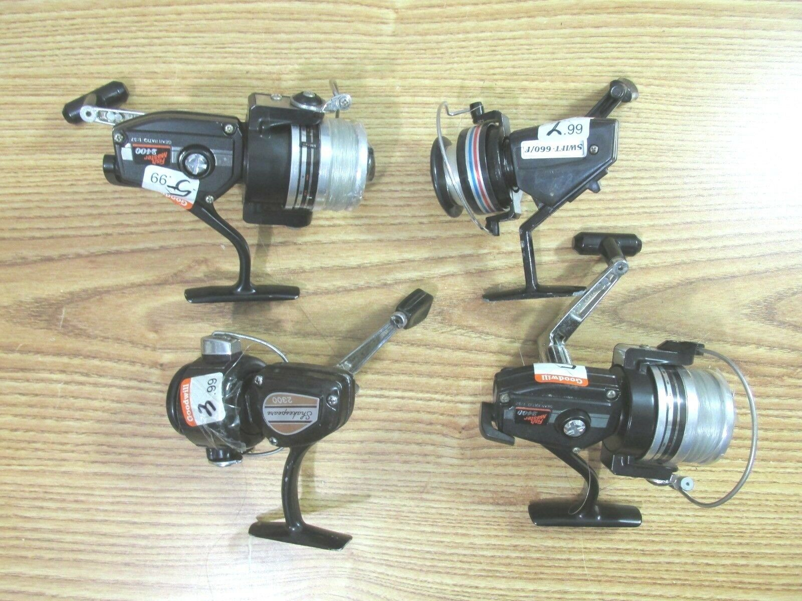 LOT OF 4 FISHING REELS SHAKESPEARE 2300, 2 FISH MASTER 2400''s, & SWIFT 660 F