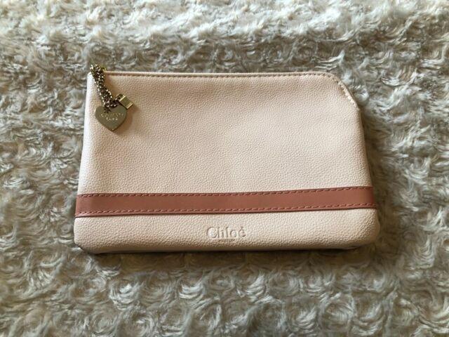 salmon pink clutch bag