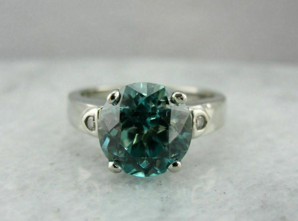 bluee Zircon Solitaire in Modern White gold Mounting