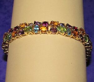 STUNNING SECONDHAND QVC 9ct YELLOW GOLD MULTIGEM LINE BRACELET 185cm - London, London, United Kingdom - Returns accepted Most purchases from business sellers are protected by the Consumer Contract Regulations 2013 which give you the right to cancel the purchase within 14 days after the day you receive the item. Find out more - London, London, United Kingdom