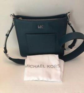 eddb989a868c Michael Kors Gloria Pocket Swing Pack Crossbody Bag Luxe Teal NWT ...