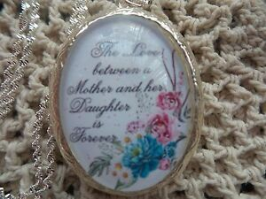 (LOCKET) THE LOVE BETWEEN A MOTHER AND HER DAUGHTER IS FOREVER FLORAL LOCKET