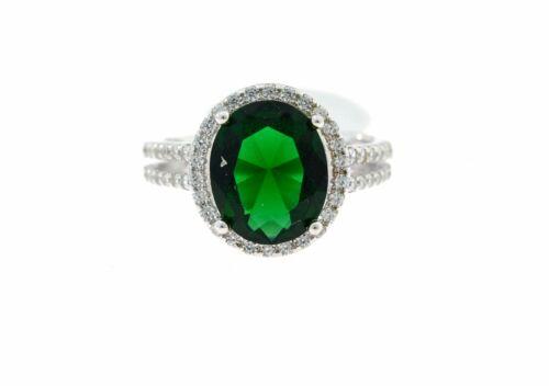 Anello con zircone da 6mm ovale color smeraldo contornato di zirconi bianchi
