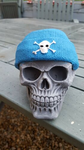 Skull wearing a beanie hat.concrete garden ornament new