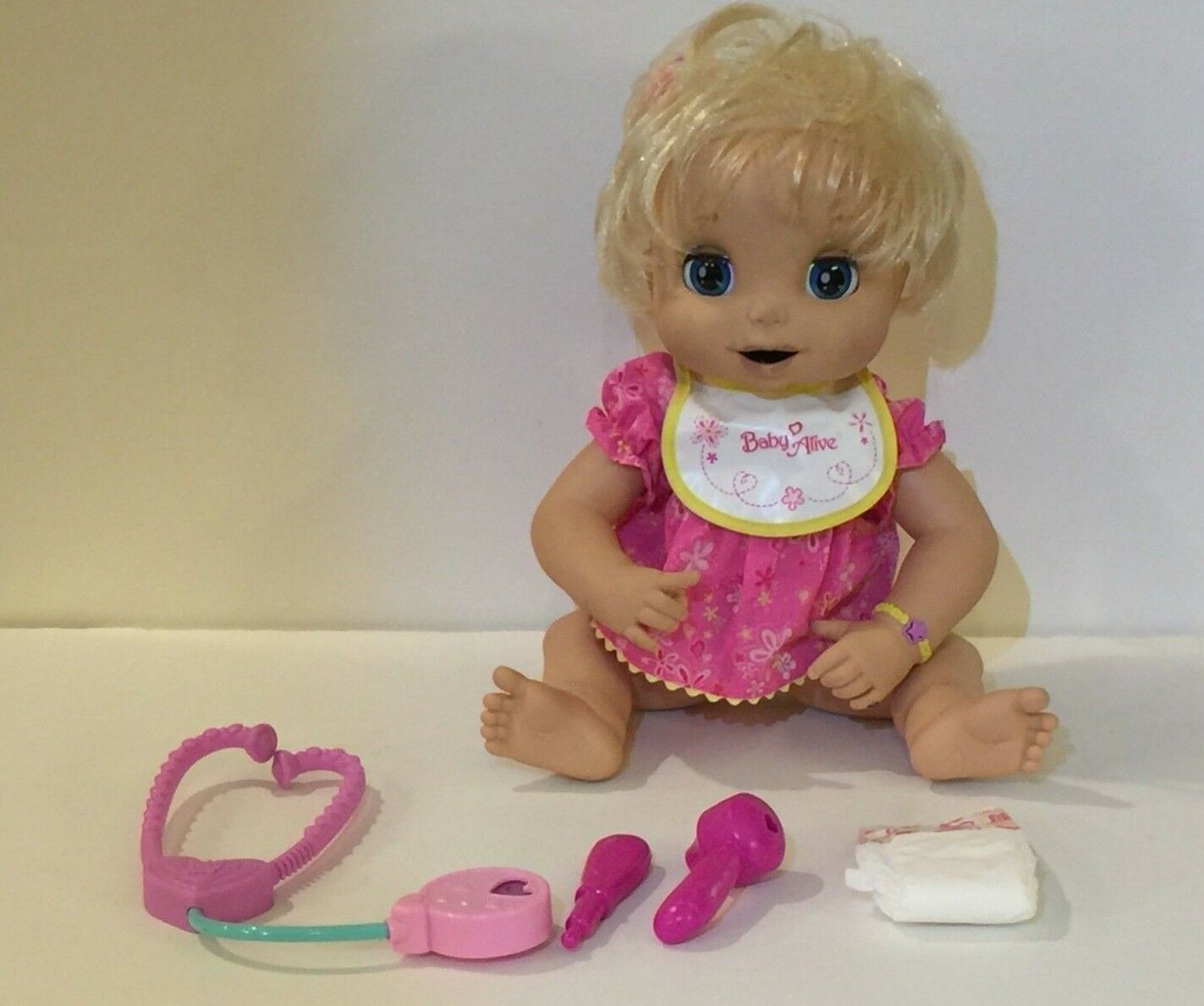 Hasbro Baby Alive Caucasian The doll Eats, Drinking & Poops It says 20+ Phases