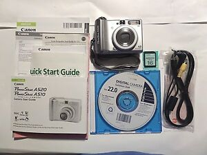 Canon-Power-Shot-A520-Digital-Camera-4MP-Silver-with-Accessories-shown-in-photo