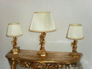 Tris lumi lampade da tavolo con putti angeli in ceramica avorio