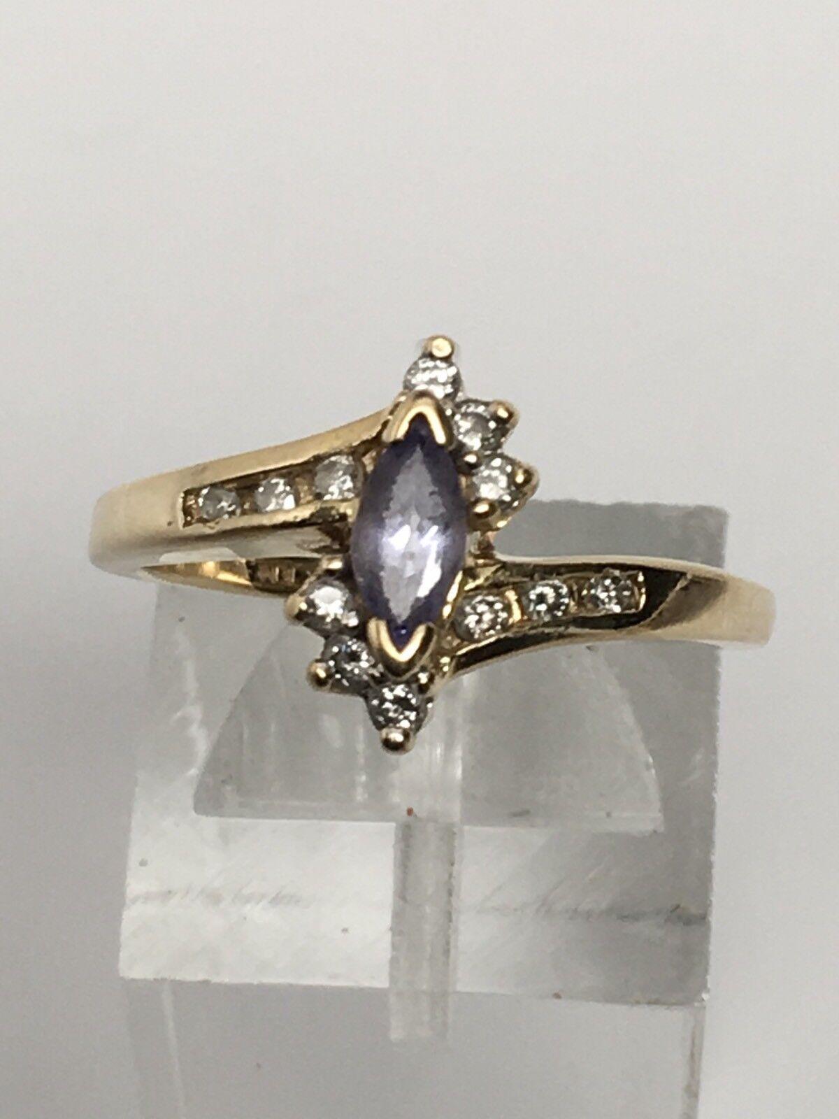 14K Yellow gold Marquise Shape Tanzanite and Natural Diamond Ring Size 6.5