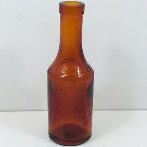 VINTAGE-GLASS-BOTTLE-ORANGE-COLOUR-BRANSON-LTD