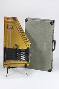 Vintage 1953 Oscar Schmidt Autoharp together with 1554029 Oscar Schmidt 21 Chord Classic Autoharp Quilted Maple Top Trans Red Os12cqtr furthermore Autoharp moreover 131795186991 moreover Oscar Schmidt OS21CQTBL Acoustic 21 Chord Quilt Transparent Blue Autoharp 172823356045 Ebay. on oscar schmidt 12 chord autoharp