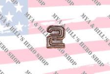 """Number """"3"""" Bronze Ribbon Attachment Device Appurtenances."""