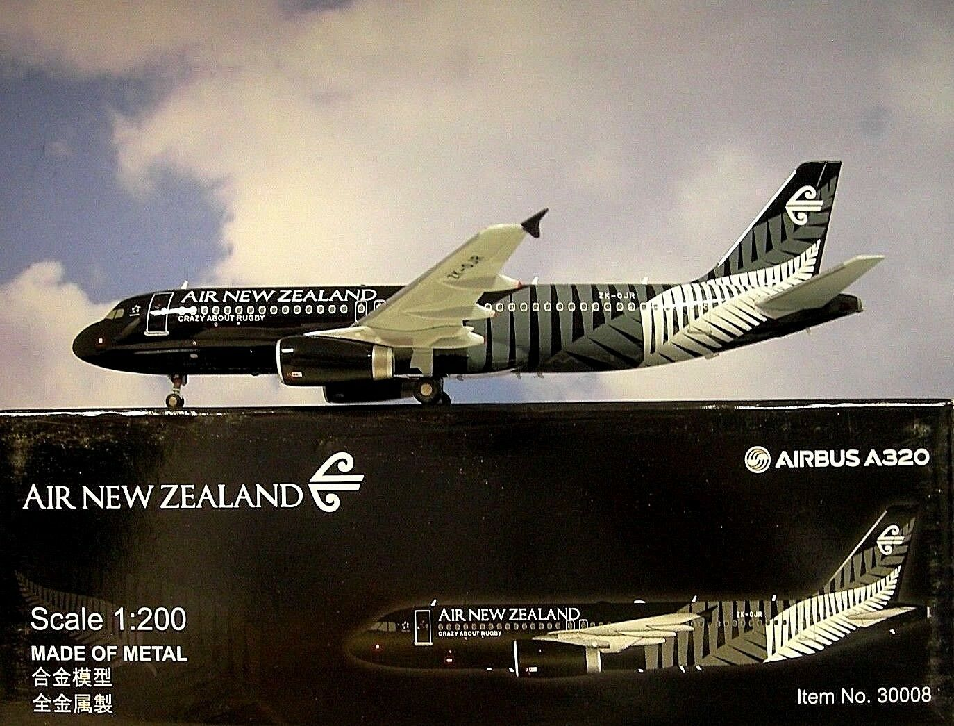 Hogan Wings 1 200 Airbus A320 Air New Zealand Zk-Ojr LI30008 + Herpa Catálogo