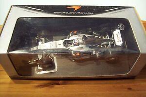 1-18-McLaren-MP4-19-Mercedes-2004-Caja-de-equipo-Kimi-Raikkonen