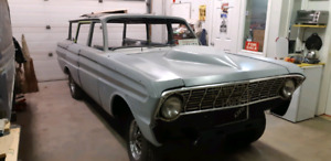 1964 Ford Falcon This Is A Falcon Squire Wagon With The Wood Grain Siding Electric Tailgate  Price  14500.00  Phone number 1705 875 7249