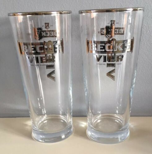 2 X New Becks Vier 1//2 Pint Glasses Embossed In Silver With Silver Rim.