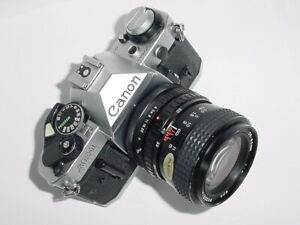 Canon-AE-1-Program-35mm-SLR-Film-MANUAL-Camera-w-Tokina-25-50mm-F4-RMC-II-Lens