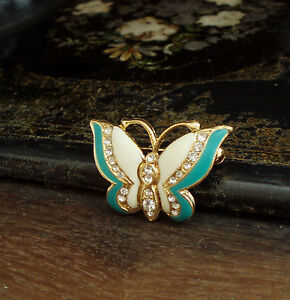Vintage Cream and Blue Green Enamel Butterfly Brooch with Crystals Reduced - <span itemprop=availableAtOrFrom>Ashford, Kent, United Kingdom</span> - Returns accepted Most purchases from business sellers are protected by the Consumer Contract Regulations 2013 which give you the right to cancel the purchase within 14 days after th - Ashford, Kent, United Kingdom