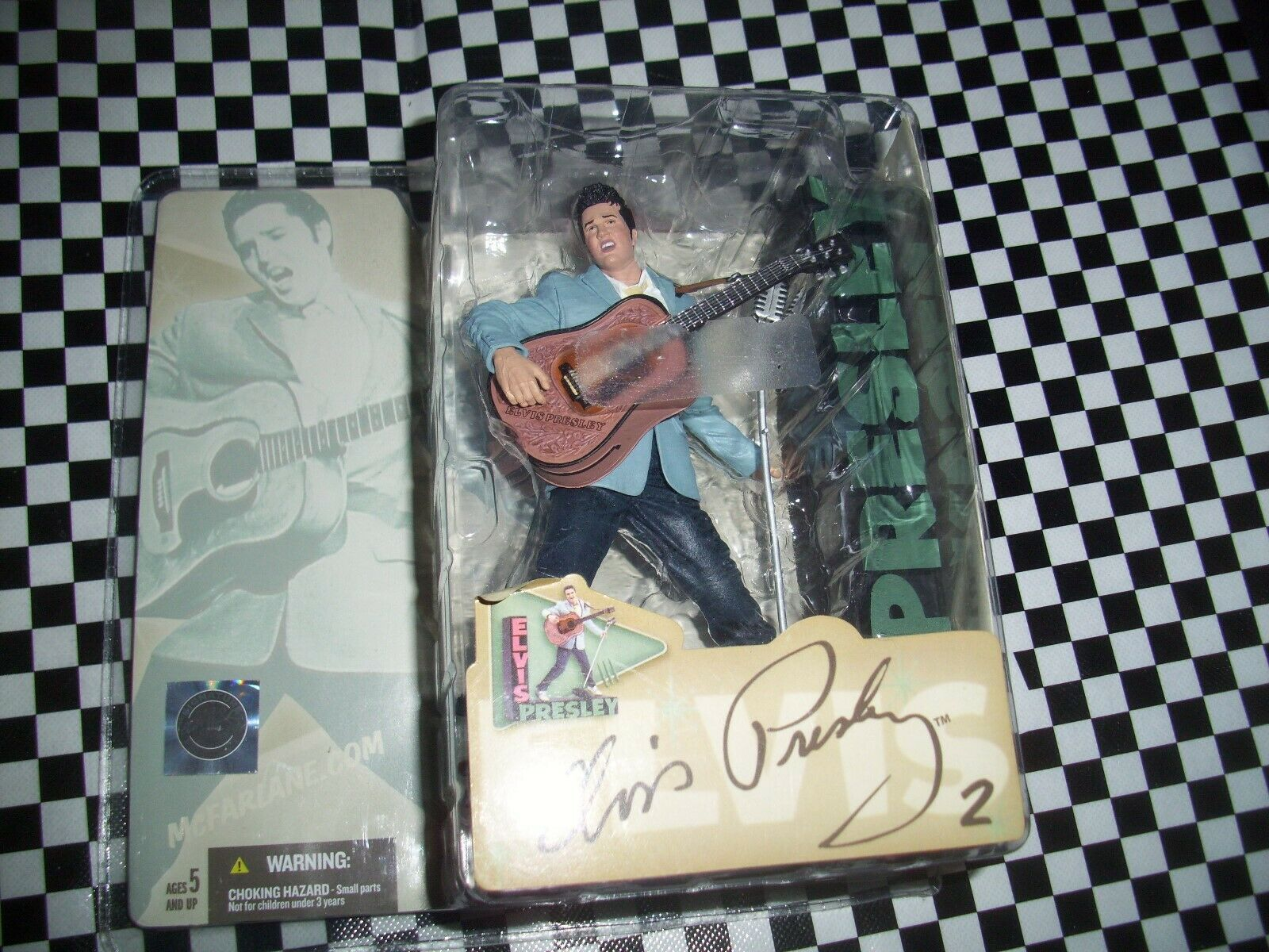 McFarlane Elvis Presley cifra 2