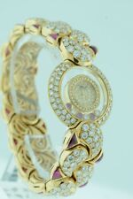 Chopard Happy Diamond and Rubies $157,000.00 ladies 18k Yellow Gold watch.