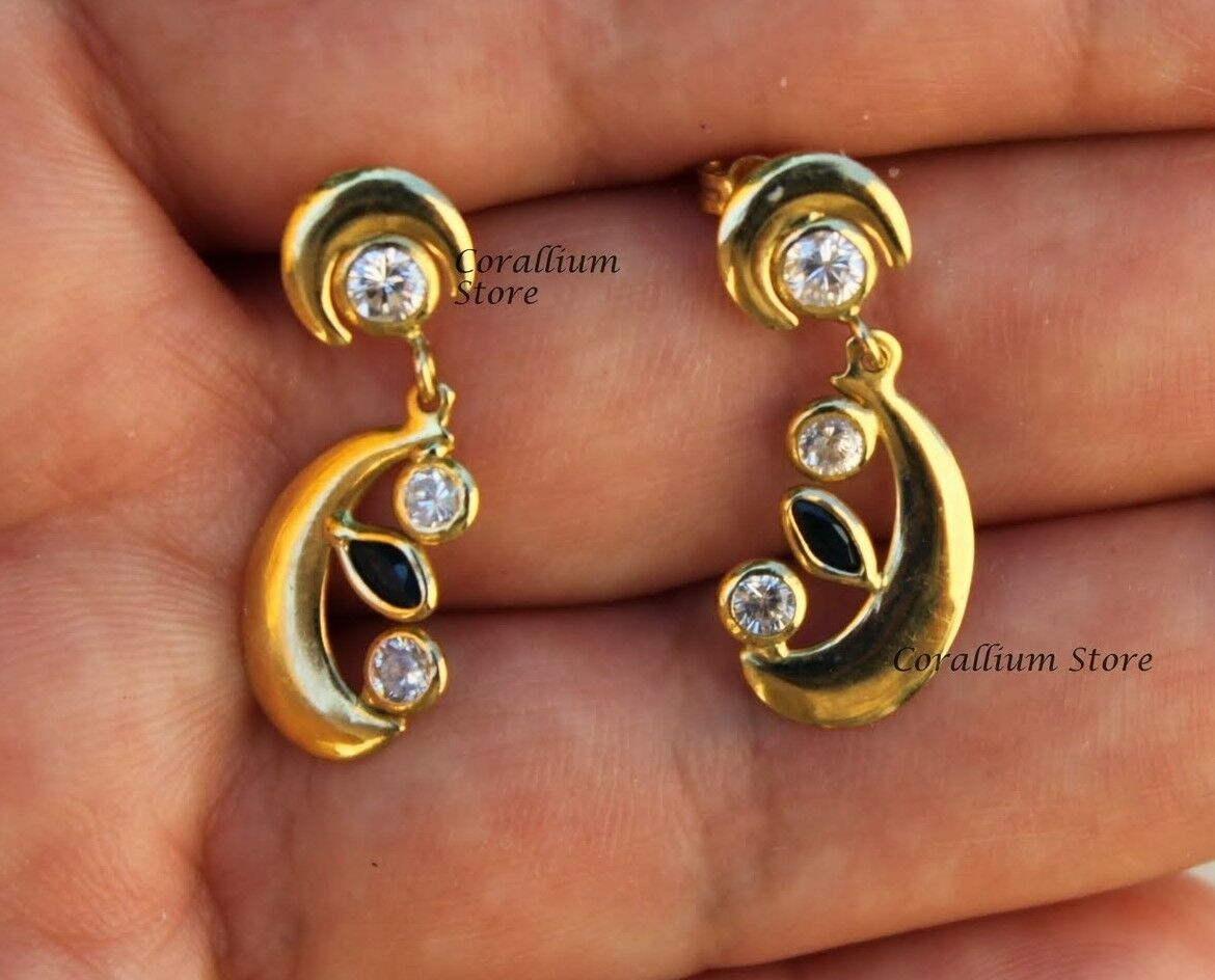 Earrings 18 carats gold, zirconium 3.3mm and onyx