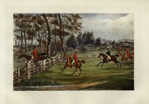 FOXHOUNDS HUNTING THE COUNTRYSIDE RED COAT HUNTERS HORSES JUMPING THE FENCE DOGS
