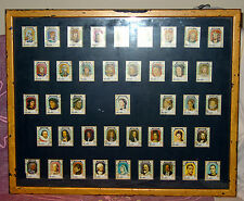 VINTAGE FRAMED SET (41) OF KINGS & QUEENS STAMPS FROM UMM AL QIWAIN ALL FRANKED