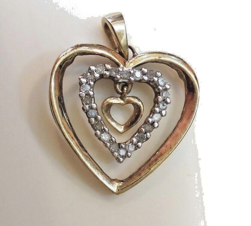 10K Diamond gold Triple Heart Floating Middle Pendent 1 4 Carat