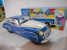 police car tole tin toy St john