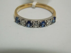 Blue sapphires & diamonds seven stones wedding anniversary band on