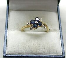 Lovely Gold Gilded Silver Blue Topaz And Diamond Flower Shaped Ring